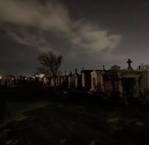 above ground tombs in a cemetery at night