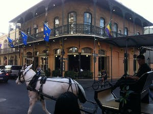 a horse drawn carriage in front of a building