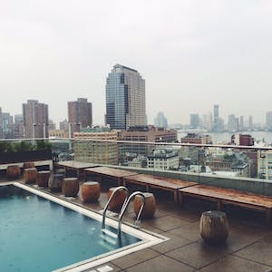 a rooftop pool overlooking a city