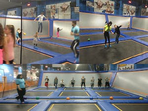 people jumping on trampolines at an indoor trampoline park