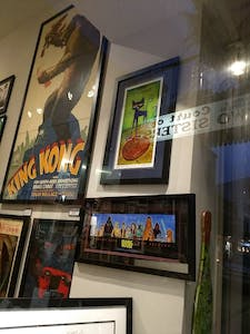 a store front with framed movie posters