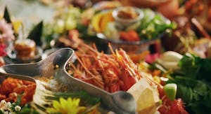 a close up of a bowl of seafood and greens