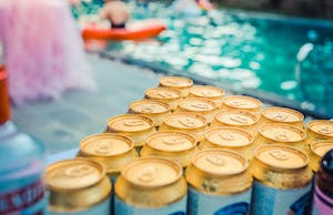 beers with a pool in the background
