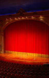 a close up of a red curtain in a theater