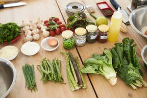 a wooden cutting board with fresh ingredients