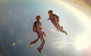 Team Building Indoor Sky Diving. Two people sky diving