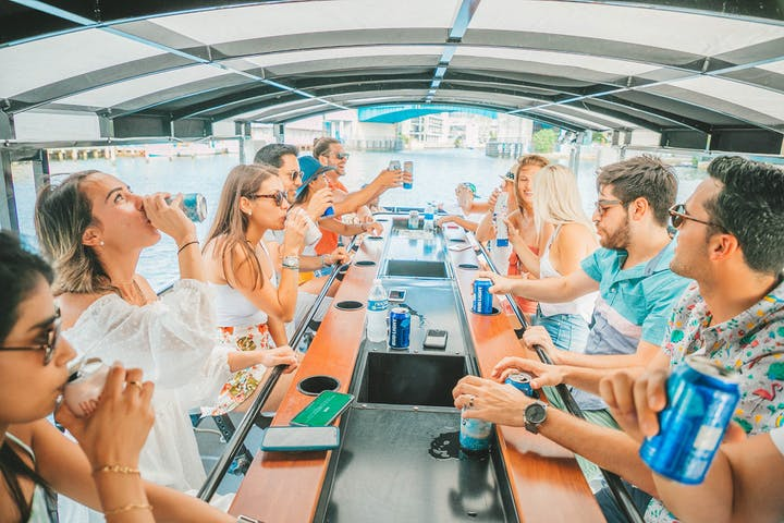 people partying on a nola booze cruise pedal boat