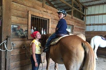 Kathleen Hanna riding a horse