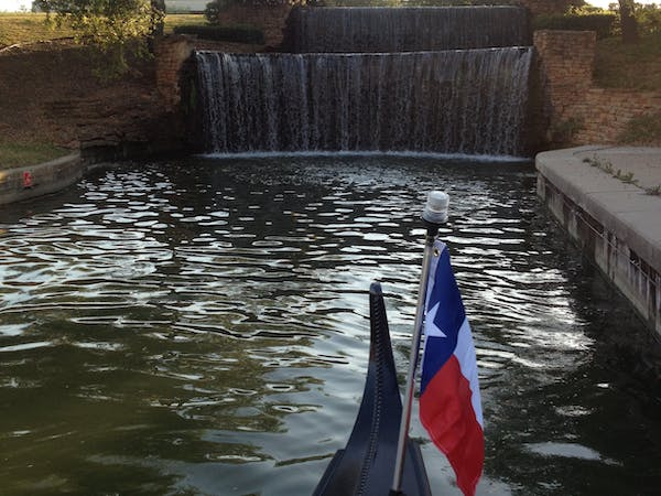 texas flag on gondola near waterfall