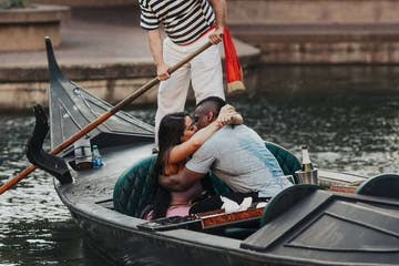 a person riding on the back of a boat