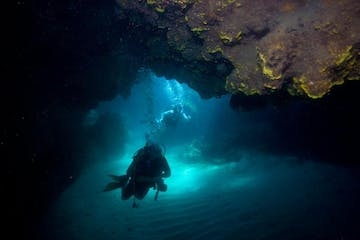Scuba diving in an underwater cave