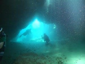 Shacks Beach scuba diving diver in an underwater cave