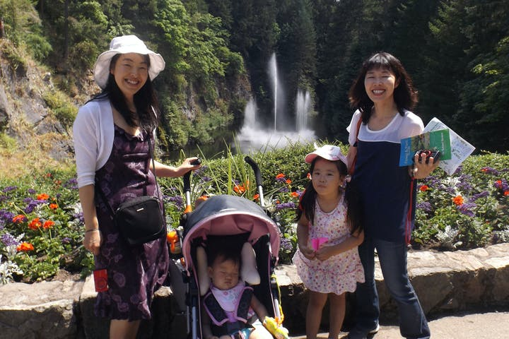 Family touring Butchart Gardens near Victoria, BC, Canada
