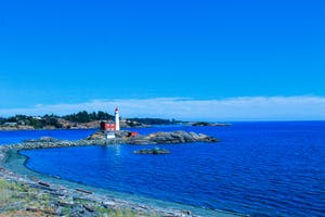 Lighthouse on ocean near Vancouver Island in BC, Canada