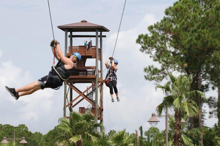women ziplining