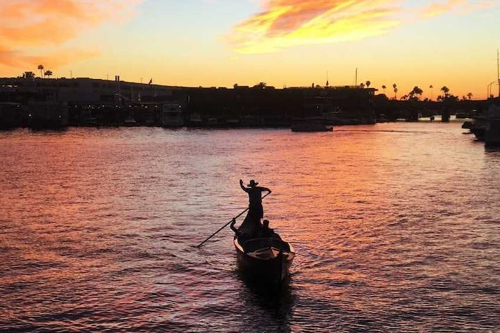 silhouette of gondolier in sunset