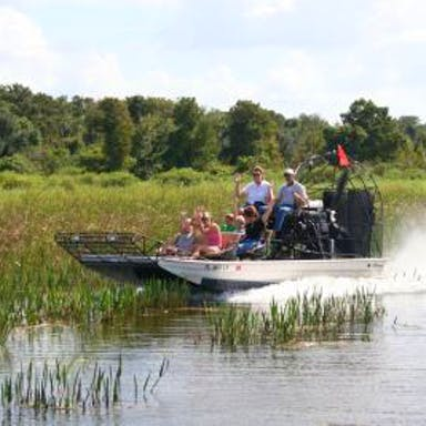 An airboat tour cruises over the Everglades