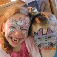 Two kids smile after facepainting