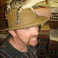 A man with an alligator on his head
