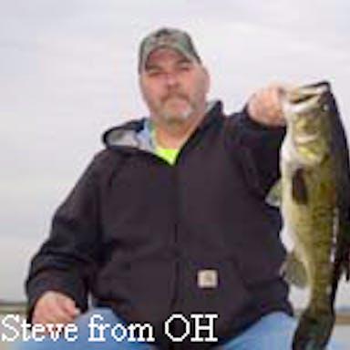 A fisherman with a bass caught on Lake Toho