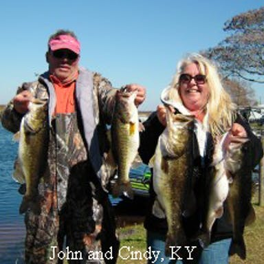 A couple poses with bass caught on Lake Toho