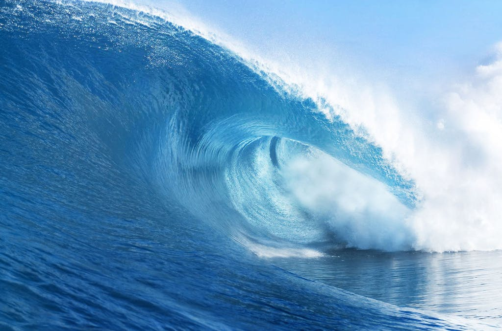 a man riding a wave in the ocean