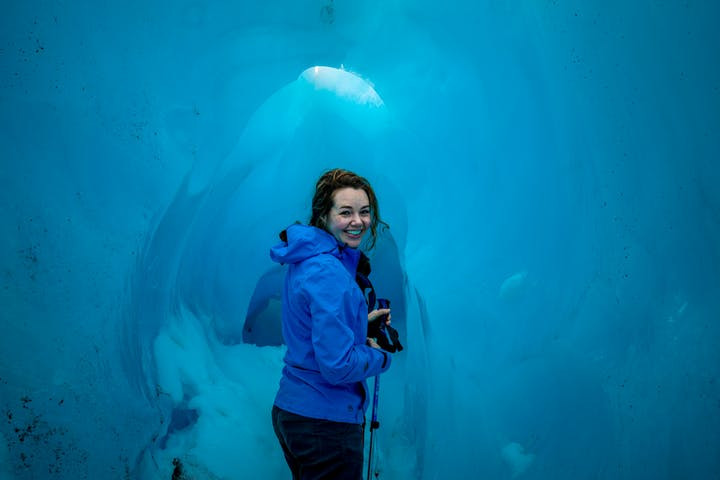 Women standing in an ice cave