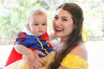 Princess Belle holding child