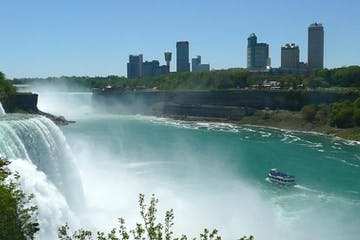 A Niagara Falls freedom tour against the Toronto skyline.