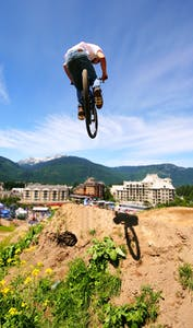 A mountainbiker floats through the air in Whistler, BC.