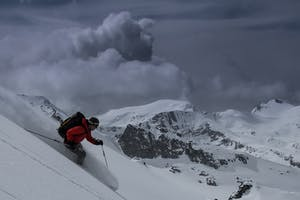 Man skiing Whistler on a grey day