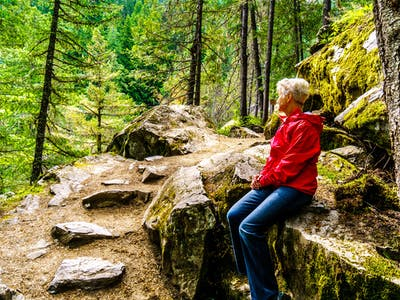 Woman resting on a hike alongside the Lillooet River to Nairn Fa