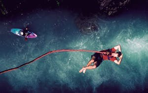 Man above water after bungee jumping in Whistler