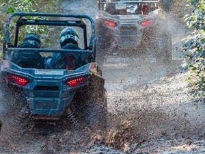 Rzr tour in Whistler through a mud puddle.