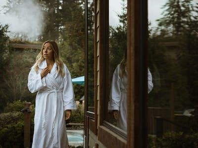 Woman in a robe walking in Scandinave Spa