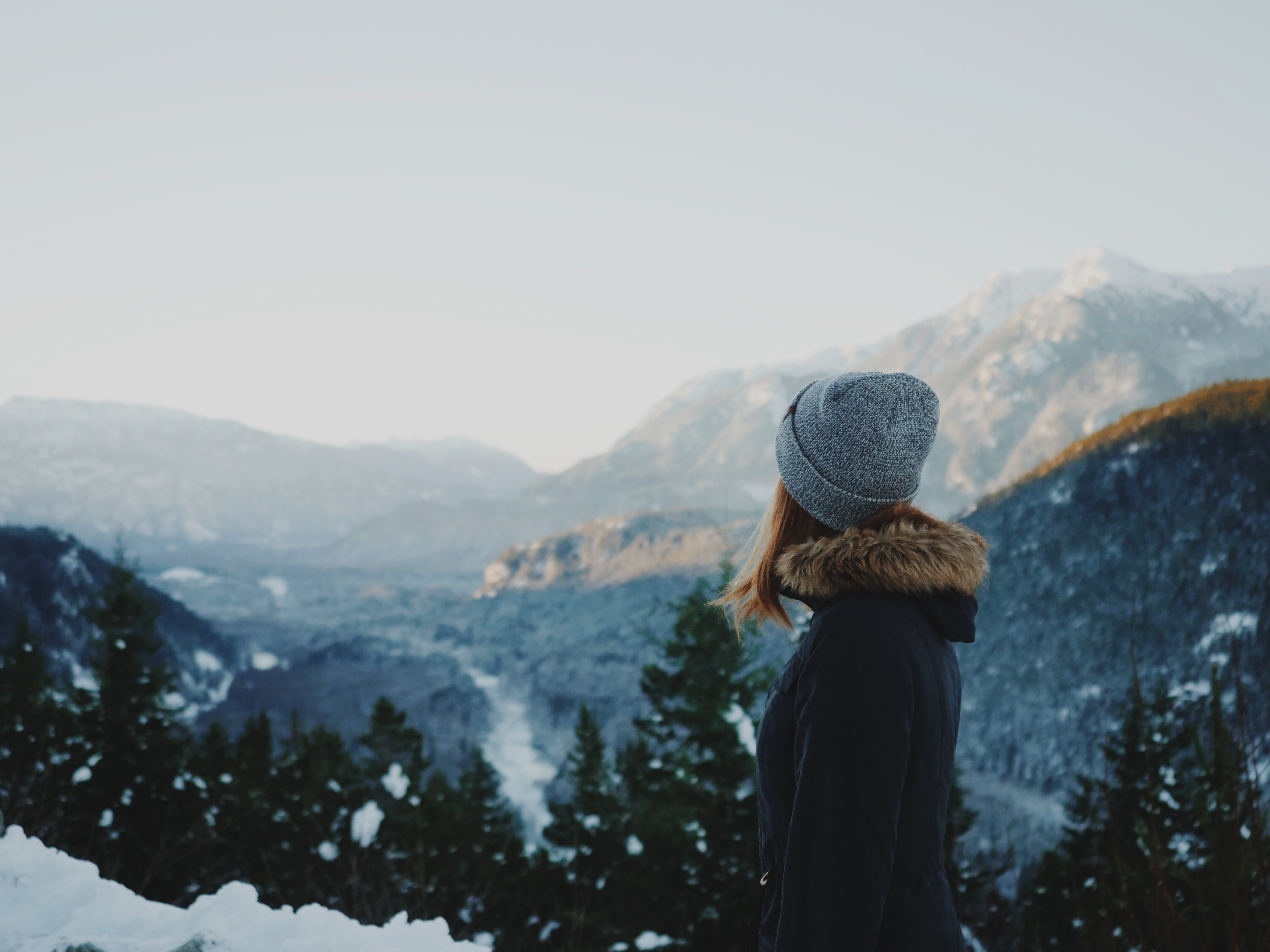 Woman looking over mountains