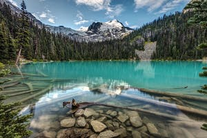 Crystal clear water, mountains and forest of Joffre Lake Canada