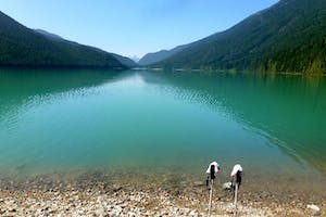 a body of water with a mountain in the background, cheakamus lake