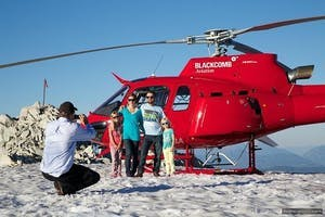 Family posing in front of Blackcomb Helicopters