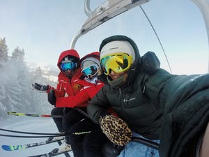 Three people on a Whistler Ski lift.
