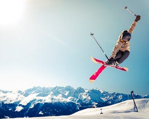 Professional skier trick in front of Whistler Blackcomb