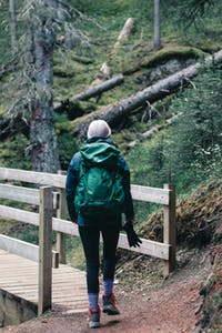 woman hiking in pacific northwest, wooden trail