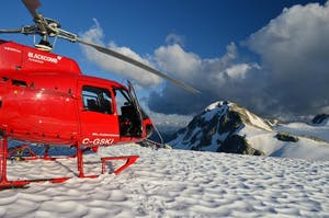 Blackcomb Helicopter, on a peak, covered in snow