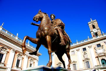 a horse statue in front of a building