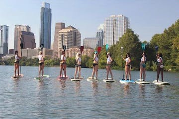 Hooters girls on paddle boards
