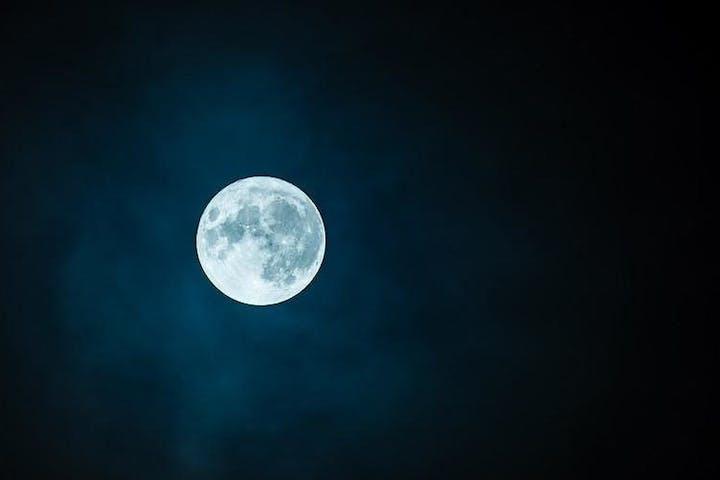 Full moon in a dark sky
