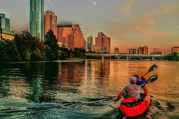 Kayakers on the river at sunset
