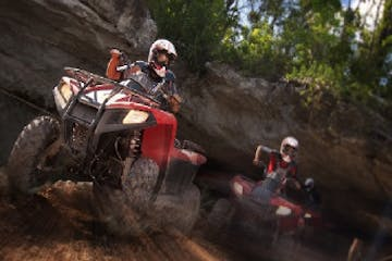 People riding ATVs