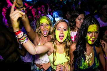 People inside of club with yellow paint