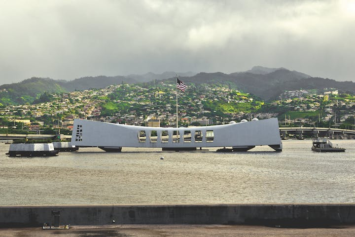 Arizona memorial with Hawaiin hills in background